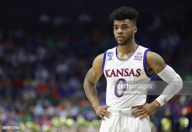 Frank Mason III of the Kansas Jayhawks watches on against the UC Davis Aggies during the first round of the 2017 NCAA Men's Basketball Tournament at...