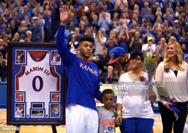 Frank Mason III of the Kansas Jayhawks waves to the crowd as he is recognized during senior night prior to a game against the Oklahoma Sooners at...