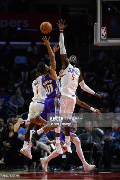 Frank Mason III of the Sacramento Kings attempts a lay up against Montrezl Harrell of the Los Angeles Clippers on October 12 2017 at STAPLES Center...