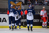 Frank Mauer Keith Aucoin and Florian Kettemer of Red Bull Muenchen celebrate during the Champions Hockey League group stage game between Red Bull...
