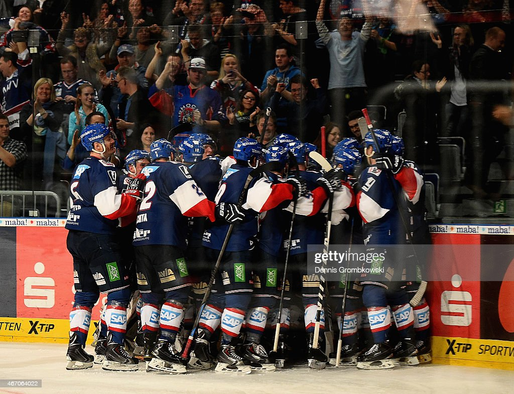 frank mauer of adler mannheim celebrates with team mates as he scores the winning goal in. Black Bedroom Furniture Sets. Home Design Ideas