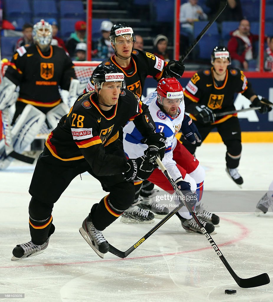 Frank Mauer (L) of Germany and Alexander Radulov (R) of Russia battle for the puck during the IIHF World Championship group H match between Germany and Russia at Hartwall Areena on May 5, 2013 in Helsinki, Finland.