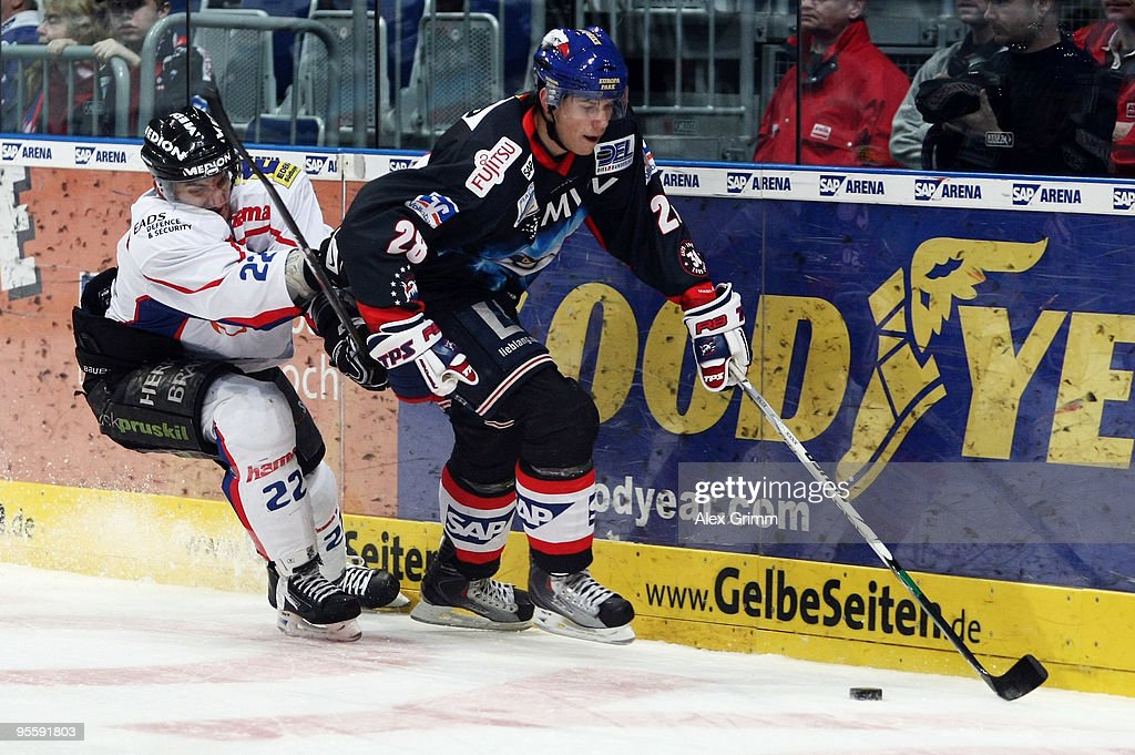Frank Mauer of Mannheim is challenged by Michael Bakos of Ingolstadt during the DEL match between Adler Mannheim and ERC Ingolstadt at the SAP Arena...