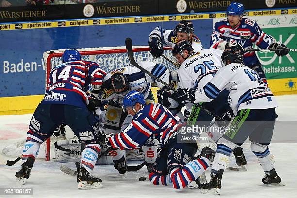 Frank Mauer of Mannheim tries to score during the DEL match between Adler Mannheim and Straubing Tigers at SAP Arena on January 26 2014 in Mannheim...