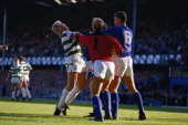 Frank McAvennie of Celtic is grabbed by the throat by a Rangers player as Chris Woods and Terry Butcher also of Rangers step in during the Scottish...