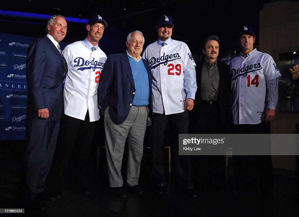 Frank McCourt Luis Gonzalez Tommy Lasorda Jason Schmidt Ned Colletti and Mike Lieberthal pose at press conference at Dodger Stadium in Los Angeles...