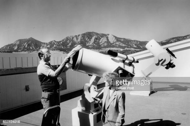 Frank Melsheimer president of DFM Engineering Inc of Longmont uncovers sixteen inch telescope at University of Colorado SormnersBausch Observatory as...