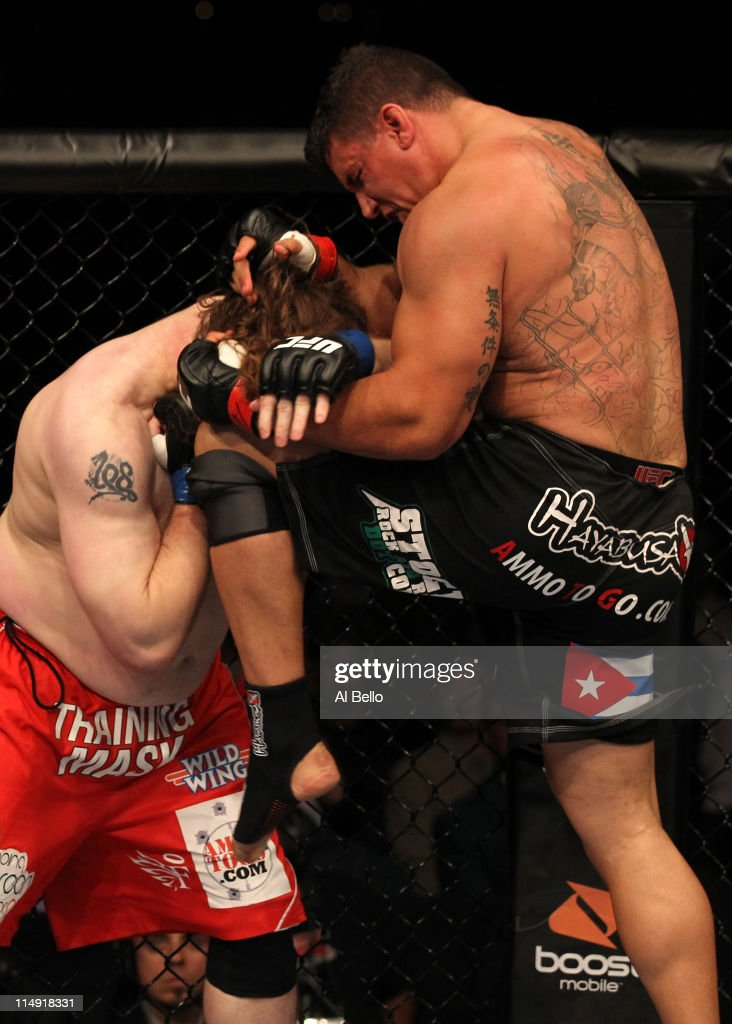 Frank Mir knees Roy Nelson during their heavyweight fight at UFC 130 at the MGM Grand Garden Arena on May 28 2011 in Las Vegas Nevada