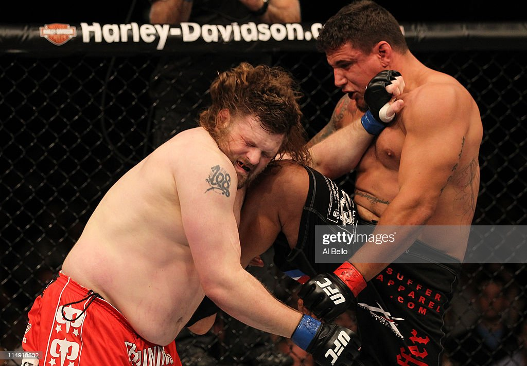<a gi-track='captionPersonalityLinkClicked' href=/galleries/search?phrase=Frank+Mir&family=editorial&specificpeople=3643624 ng-click='$event.stopPropagation()'>Frank Mir</a> knees <a gi-track='captionPersonalityLinkClicked' href=/galleries/search?phrase=Roy+Nelson&family=editorial&specificpeople=4230645 ng-click='$event.stopPropagation()'>Roy Nelson</a> during their heavyweight fight at UFC 130 at the MGM Grand Garden Arena on May 28, 2011 in Las Vegas, Nevada.