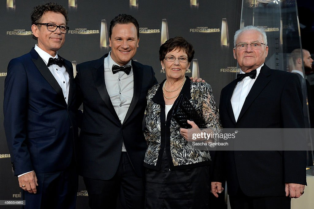 Frank Mutter, Guido Maria Kretschmer, his mother Marianne Kretschmer and his father Erich Kretschmer arrive at the 'Deutscher Fernsehpreis 2014' at Coloneum on October 2, 2014 in Cologne, Germany.
