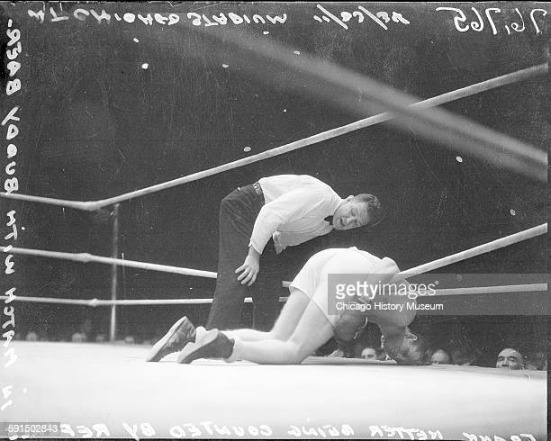 Frank Netter lying on ropes in boxing ring while referee counts during a boxing match with Buddy Baer Chicago Illinois 1935 From the Chicago Daily...