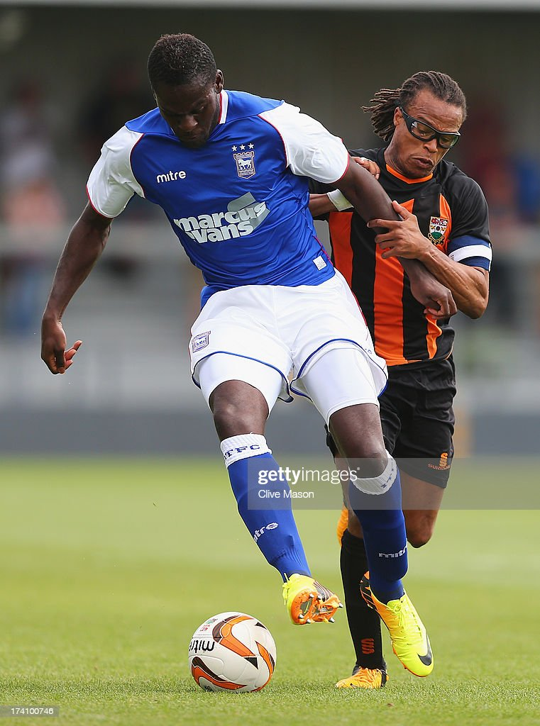 Frank Nouble of Ipswich Town is tackled by <a gi-track='captionPersonalityLinkClicked' href=/galleries/search?phrase=Edgar+Davids&family=editorial&specificpeople=213130 ng-click='$event.stopPropagation()'>Edgar Davids</a> of Barnet during the pre season friendly match between Barnet and Ipswich Town at The Hive on July 20, 2013 in Barnet, England.