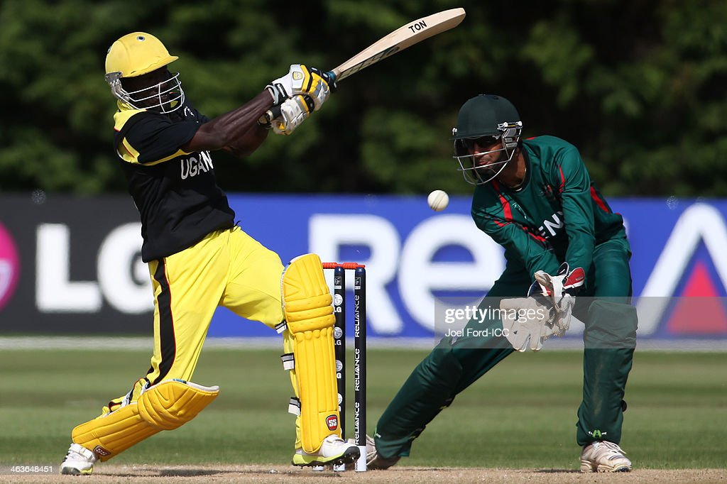 Frank Nsubuga of Uganda plays a shot in fron of wicketkeeper Ifran Karim of Kenya during an ICC World Cup qualifying match between Kenya and Uganda on January 19, 2014 in Mount Maunganui, New Zealand.