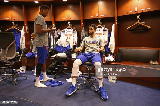 Frank Ntilikina and Courtney Lee of the New York Knicks get ready before the game against the Cleveland Cavaliers on November 13 2017 at Madison...