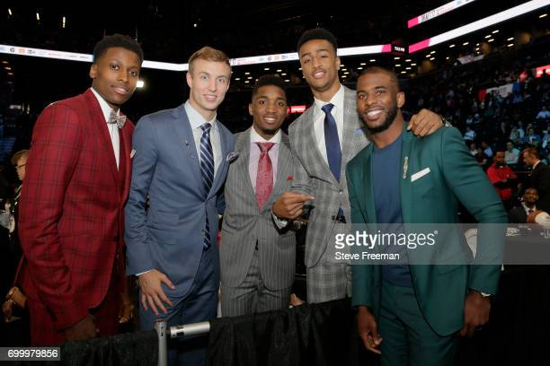 Frank Ntilikina Luke Kennard Donovan Mitchell and John Collins pose for a photo with Chris Paul of the LA Clippers before the 2017 NBA Draft on June...