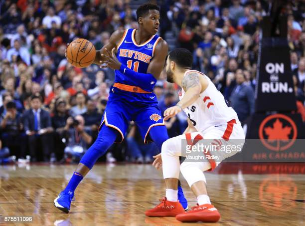 Frank Ntilikina of the New York Knicks dribbles the ball as Fred VanVleet of the Toronto Raptors defends during the first half of an NBA game at Air...