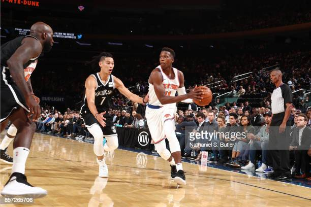 Frank Ntilikina of the New York Knicks handles the ball against Jeremy Lin of the Brooklyn Nets during the preseason game on October 3 2017 at...