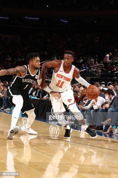 Frank Ntilikina of the New York Knicks handles the ball against D'Angelo Russell of the Brooklyn Nets during the preseason game on October 3 2017 at...