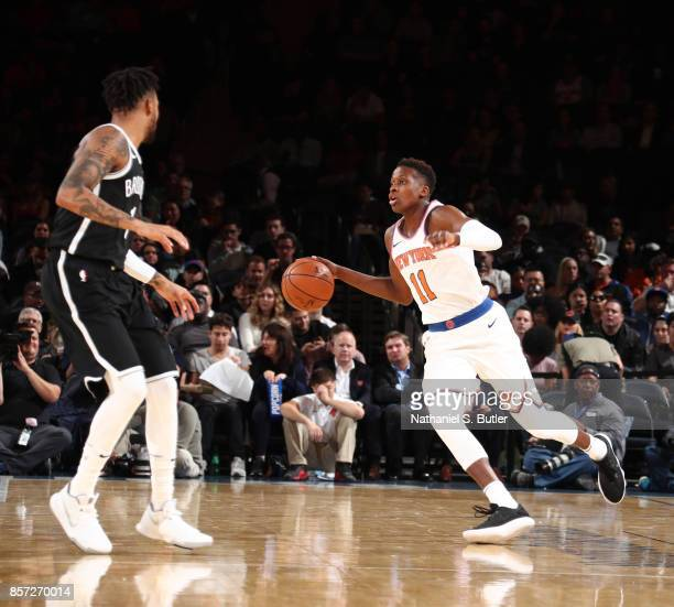 Frank Ntilikina of the New York Knicks handles the ball against the Brooklyn Nets during the preseason game on October 3 2017 at Madison Square...