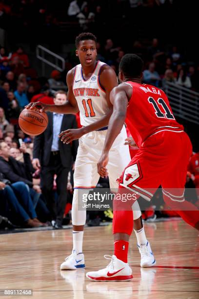 Frank Ntilikina of the New York Knicks handles the ball against the Chicago Bulls on December 9 2017 at the United Center in Chicago Illinois NOTE TO...