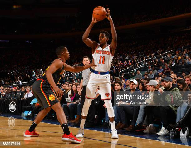 Frank Ntilikina of the New York Knicks looks to pass the ball inside against the Atlanta Hawks at Madison Square Garden on December 10 2017 in New...