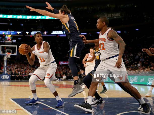 Frank Ntilikina of the New York Knicks looks to pass to teammate Lance Thomas as Ricky Rubio of the Utah Jazz defends in the first half at Madison...