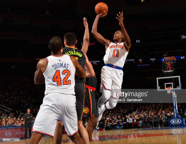 Frank Ntilikina of the New York Knicks shoots the ball against the Atlanta Hawks at Madison Square Garden on December 10 2017 in New York New York...