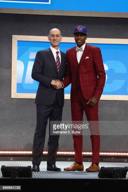 Frank Ntilikina shakes hands with NBA Commissioner Adam Silver after being selected number eight overall by the New York Knicks during the 2017 NBA...
