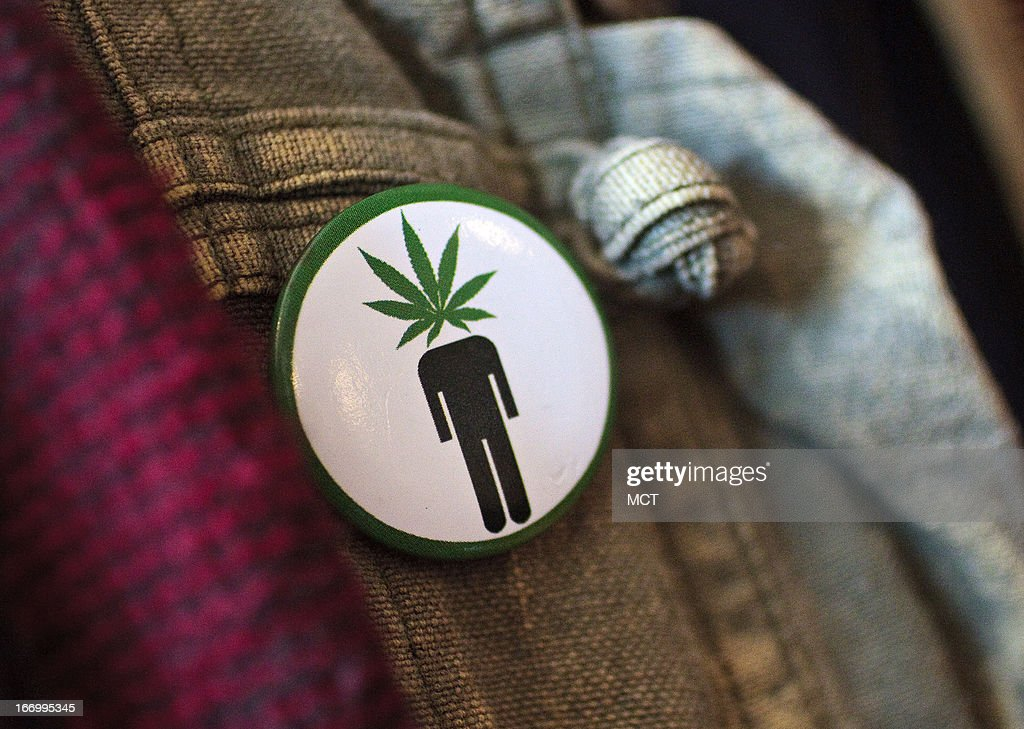 Frank Nuccio wears a 'pothead' button on his jacket while attending a cannabis cooking class in Denver, Colorado, on Thursday, April 18, 2013.