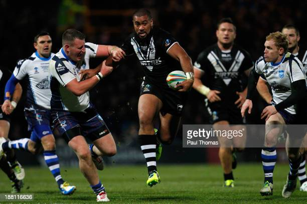 Frank Pritchard of New Zealand in action with Sam Barlow of Scotland during the Rugby League World Cup Quarter Final match between New Zealand and...