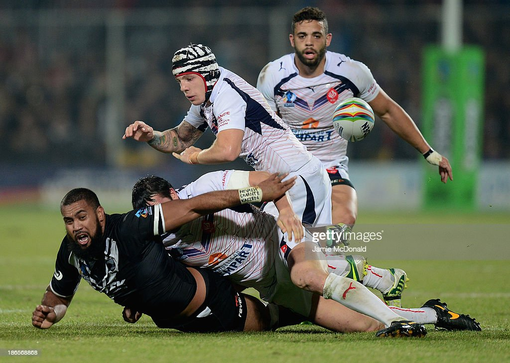 Frank Pritchard of New Zealand is tackled by Mickael Simon and Theo Fages during the Rugby League World Cup group B match between New Zealand and France at Parc des Sports on November 1, 2013 in Avignon, France.