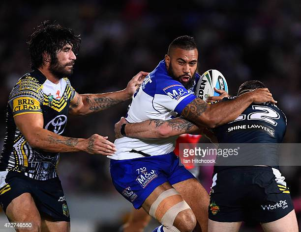 Frank Pritchard of the Bulldogs is tackled by Ethan Lowe and James Tamou of the Cowboysduring the round nine NRL match between the North Queensland...