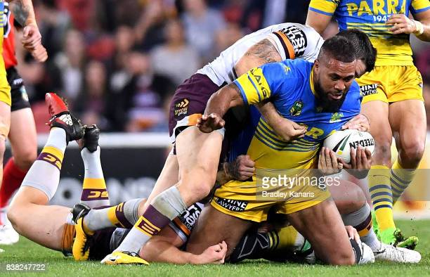Frank Pritchard of the Eels is tackled during the round 25 NRL match between the Brisbane Broncos and the Parramatta Eels at Suncorp Stadium on...