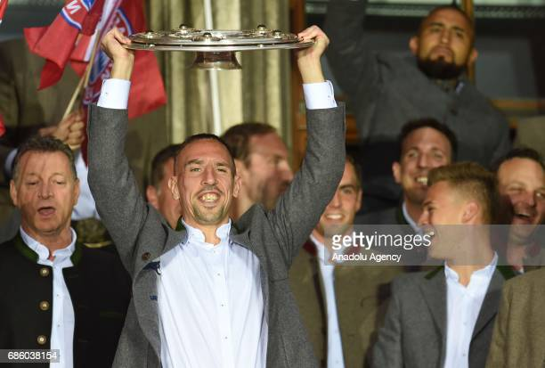 Frank Ribery of Bayern Munich celebrates winning the German soccer championship with the trophy on a balcony of the town hall in Munich Germany on...