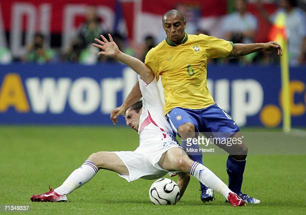 Frank Ribery of France tangles with Roberto Carlos of Brazil during the FIFA World Cup Germany 2006 Quarterfinal match between Brazil and France at...