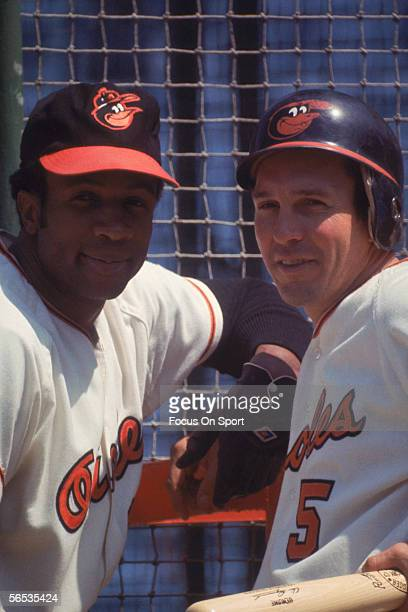Frank Robinson and Brooks Robinson of the Baltimore Orioles pose during practice at Memorial Stadium circa 1970 in Baltimore Maryland