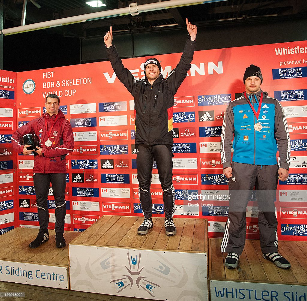 Frank Rommel of Germany raises his hands in the air to celebrate his first place win during Skeleton Men on day 2 of the IBSF 2012 Bobsleigh and Skeleton World Cup on November 24, 2012 at the Whistler Sliding Centre in Whistler, British Columbia, Canada. Martins Dukurs and Tomass Dukurs won second and third place respectively.