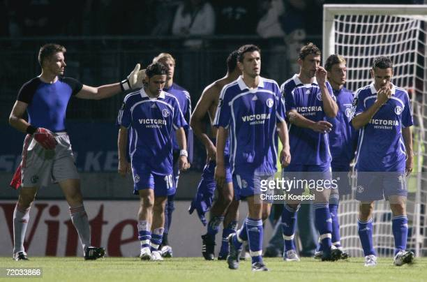 Frank Rost Lincoln Zlatan Bajramovic Marcelo Bordon and Peter Loevenkrands of Schalke walk off the pitch after losing 31 during the UEFA Cup second...