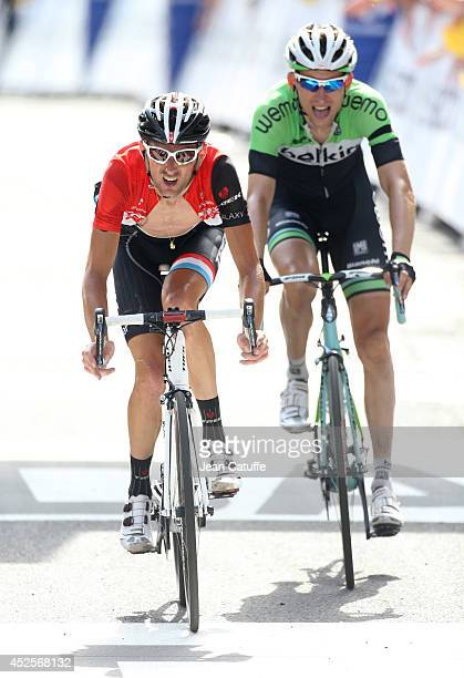 Frank Schleck of Luxembourg and Trek Factory Racing finishes in front of Bauke Mollema of the Netherlands and Belkin Pro Cycling during stage...