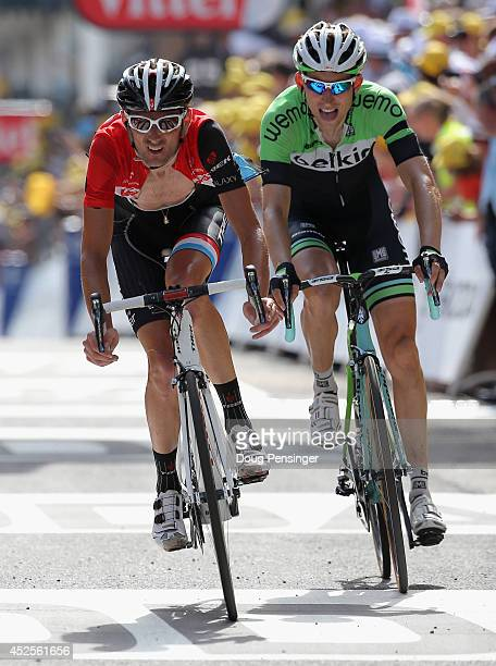 Frank Schleck of Luxembourg and Trek Factory Racing finishes in seventh place along with Bauke Mollema of The Netherlands and the Belkin Pro Cycling...