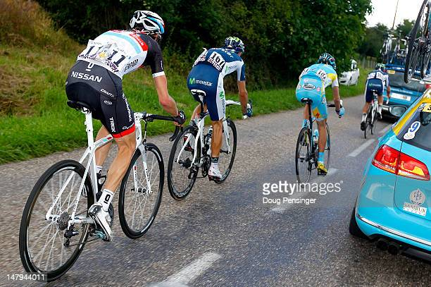 Frank Schleck of Luxemburg riding for RadioshackNissan Alejandro Valverde of Spain riding for Movistar and Janez Brajkovic of Slovenia try to chase...
