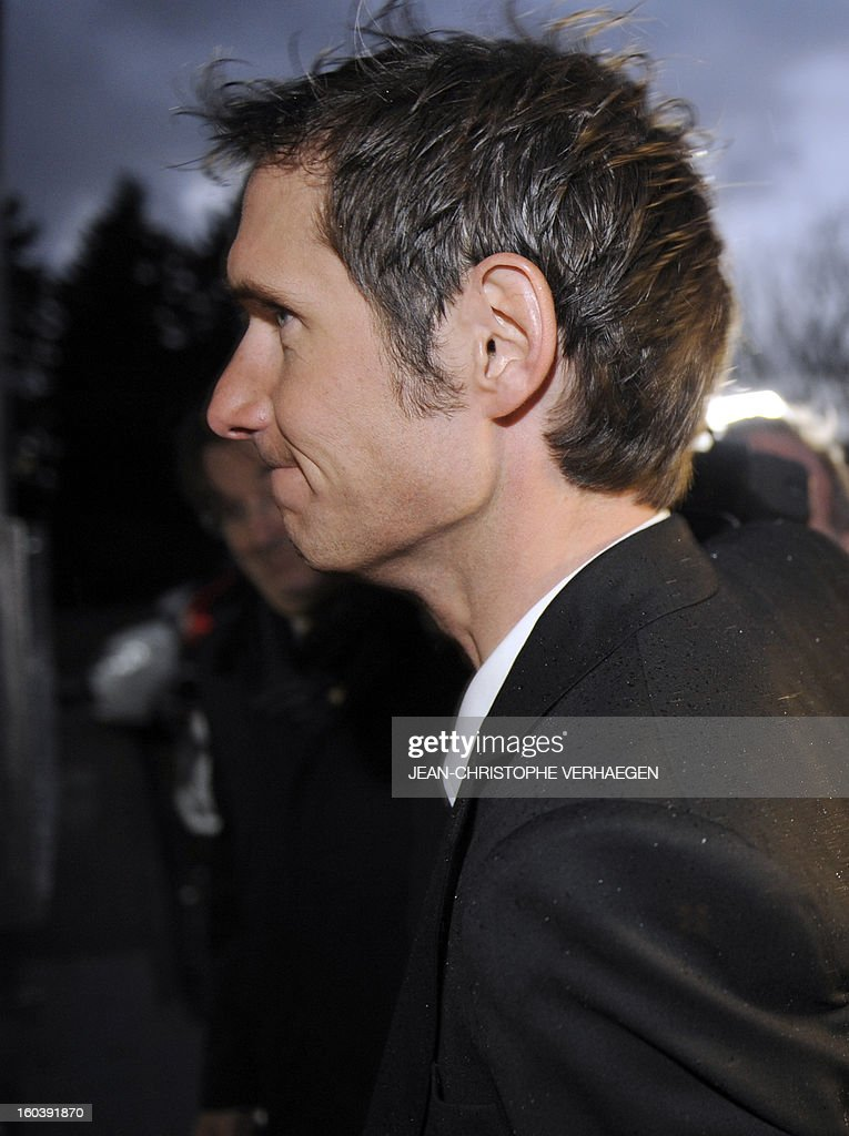 Frank Schleck (2ndR), tested positive for a diuretic (Xipamide) on the Tour de France 2012, arrives at the Luxembourg Anti-Doping Agency (Agence Luxembourgeoise Antidopage - ALAD) to learn the decision, on January 30, 2013 in Luxembourg. Schleck was banned for one year by Luxembourg's anti-doping body (ALAD) on Wednesday for failing a drugs test on last year's Tour de France, the body's president Robert Schuller announced. CHRISTOPHE VERHAEGEN