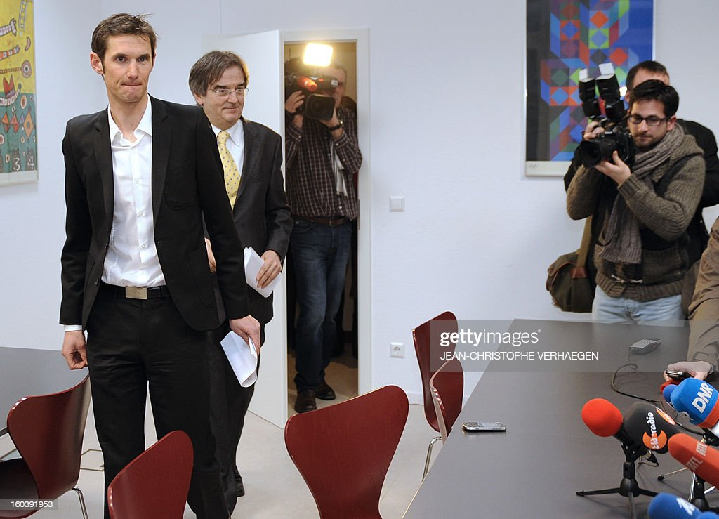 Frank Schleck (L), tested positive for a diuretic (Xipamide) on the Tour de France 2012, arrives with his lawyer Albert Rodesch for a press conference after the decision of the Luxembourg Anti-Doping Agency (Agence Luxembourgeoise Antidopage - ALAD), on January 30, 2013 in Luxembourg. Schleck was banned for one year by Luxembourg's anti-doping body (ALAD) on Wednesday for failing a drugs test on last year's Tour de France, the body's president Robert Schuller announced. AFP PHOTO / JEAN-CHRISTOPHE VERHAEGEN