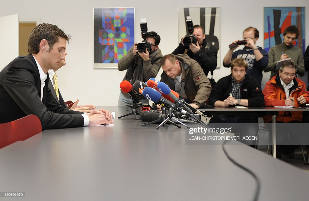 Frank Schleck (L), tested positive for a diuretic (Xipamide) on the Tour de France 2012, attends a press conference after the decision of the Luxembourg Anti-Doping Agency (Agence Luxembourgeoise Antidopage - ALAD), on January 30, 2013 in Luxembourg. Schleck was banned for one year by Luxembourg's anti-doping body (ALAD) on Wednesday for failing a drugs test on last year's Tour de France, the body's president Robert Schuller announced.