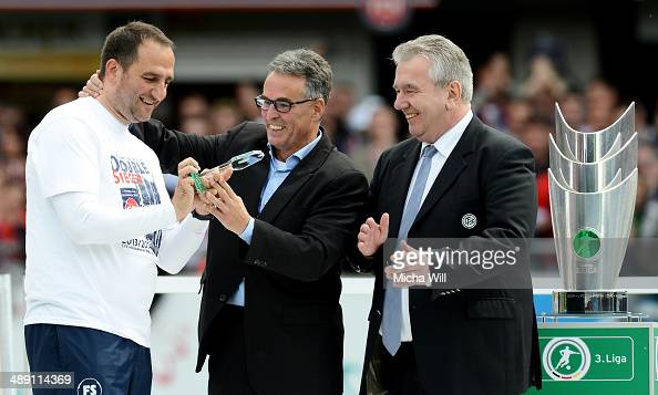 Frank Schmidt head coach of Heidenheim is honored as coach of the season 2013/2014 by Peter Frymuth and Helmut Sandrock of the DFB after the Third...