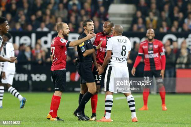 Frank Schneider referee with Wahbi Khazri of Rennes during the Ligue 1 match between EA Guingamp and Stade Rennais at Stade du Roudourou on October...