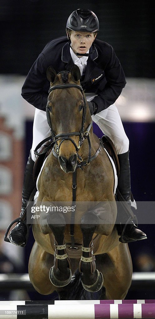 Frank Schuttert of The Netherlands rides his horse Winchester HS at the Jumping Amsterdam 2013, in Amsterdam, the Netherlands, on January 20, 2013. Schuffert won the Grand Prix of Amsterdam for international jumping 1,60m.