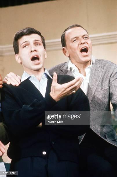 Frank Sinatra and Frank Sinatra Jr perform circa late 1960's