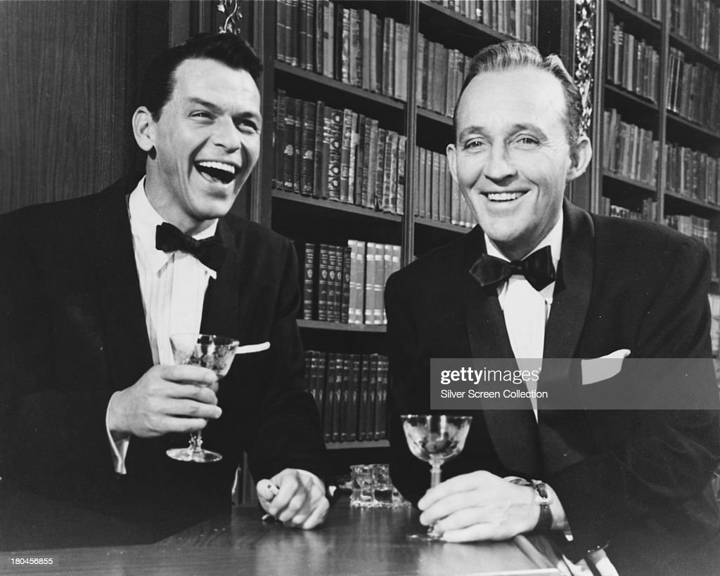 <a gi-track='captionPersonalityLinkClicked' href=/galleries/search?phrase=Frank+Sinatra&family=editorial&specificpeople=70024 ng-click='$event.stopPropagation()'>Frank Sinatra</a> (1915 - 1998, left), as Mike Connor, and <a gi-track='captionPersonalityLinkClicked' href=/galleries/search?phrase=Bing+Crosby&family=editorial&specificpeople=90412 ng-click='$event.stopPropagation()'>Bing Crosby</a> (1903 - 1977), as C.K. Dexter-Haven, in 'High Society', directed by Charles Walters, 1956.