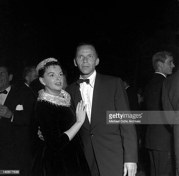 Frank Sinatra chats with actress and singer Judy Garland at the party celebrating the premiere of the Warner Bros film 'A Star Is Born' on September...